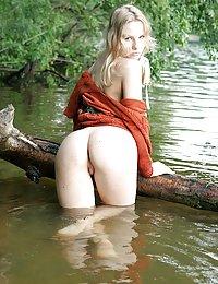 Slim teen near a lake