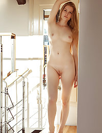 Bretona bares her slender body with pink nipples and amazing butt on the stairs.