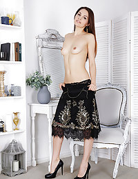 Alise Moreno sensually strips her sexy, black dress baring her smooth, pink pussy.