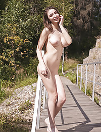 Enchanting huge titted brunette is chilling outdoors showing her curvaceous feminine body in exciting and sensual poses.