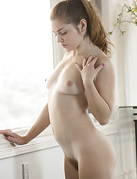 Misty Lovelace flaunts her athletic body and unshaven pussy.