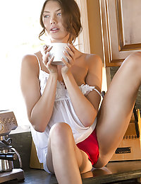 Elena Koshka displays her smoking hot body in the kitchen.