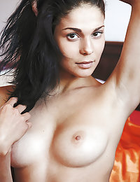 Callista B flaunts her puffy tits and wet pussy on the bed.