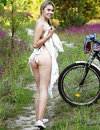 Eva Jude shows off her sexy, slender body as she rides her bike.