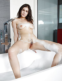 Amelie Belain strips in the tub as she dips her gorgeous body.