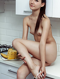 Iva strips in the kitchen as she flaunts her petite body.