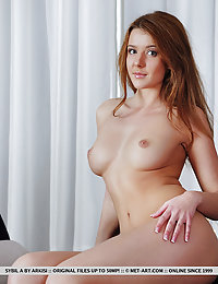 Sybil A bares her luscious, naked body and delectable pussy on the chair.